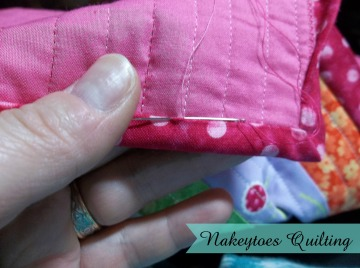 Hand sewing down the binding on the American Girl Doll Quilt