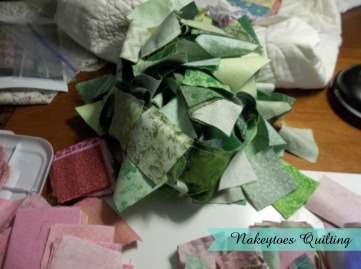 Rhubarb Pie Quilt green patches in a pile